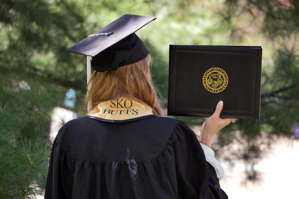 Graduating Student holding a diploma