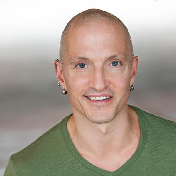 man facing front smiling