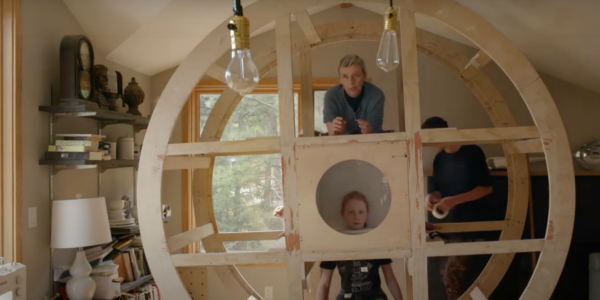 Michelle Ellsworth with a large wooden circular object