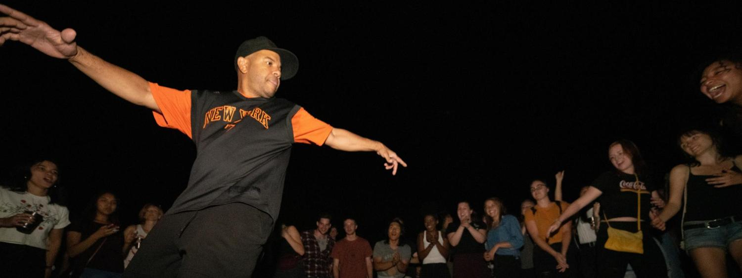 Professor Larry Southall dances in the cypher while surrounded by a crowd
