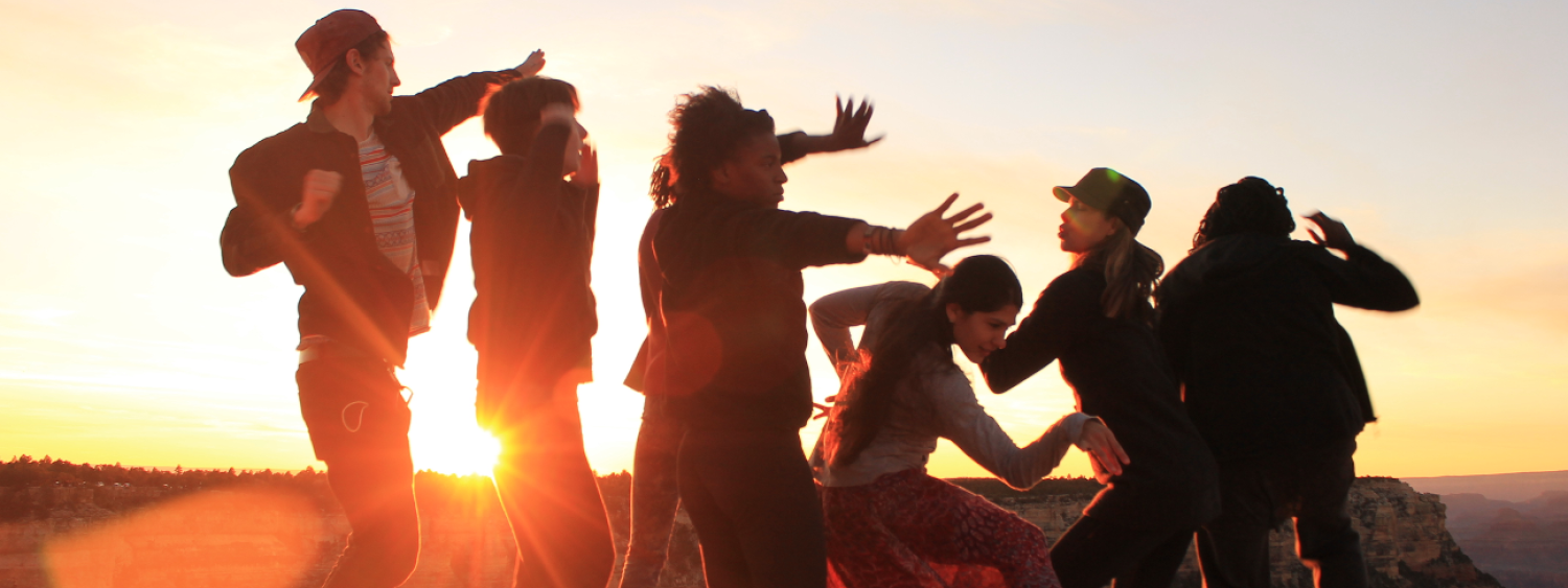 Dancers performing at sunset in the desert