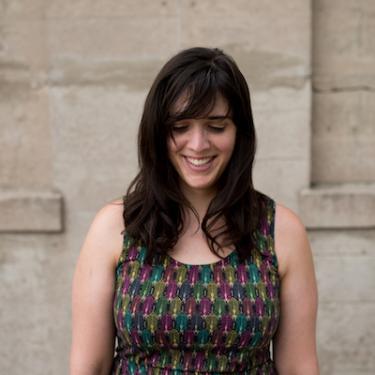 women smiling, long dark hair