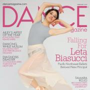 Cover of Dance magazine woman in grey leotard and pink chiffon skirt posing wearing point shoes