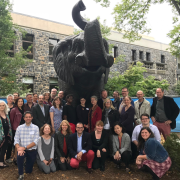 Elephant statue and group of people attending Consortium