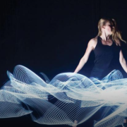 Dancer posing with lasers