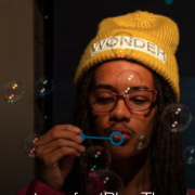 student blowing bubbles