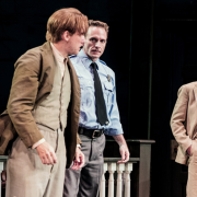 Three characters in To Kill a Mockingbird standing on stage