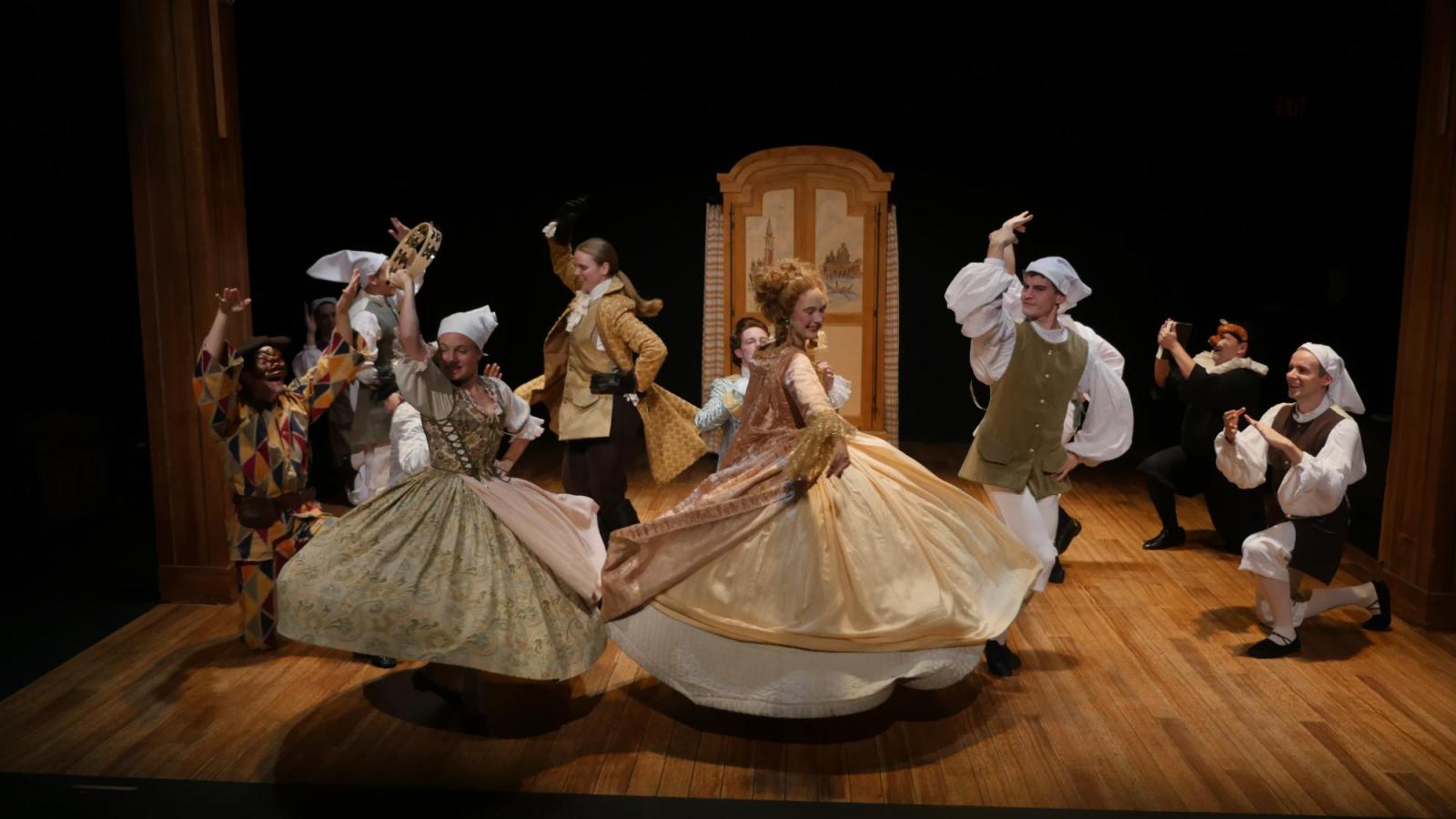 student actors dance on stage