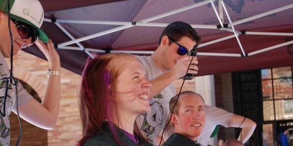 herd members shaving their heads for St. Baldrick's Day event