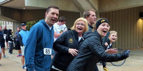 Family pretending to run