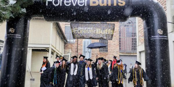 Students under a ForeverBuffs arch
