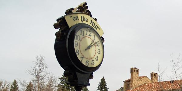 "A clock that says ""on the hill"""