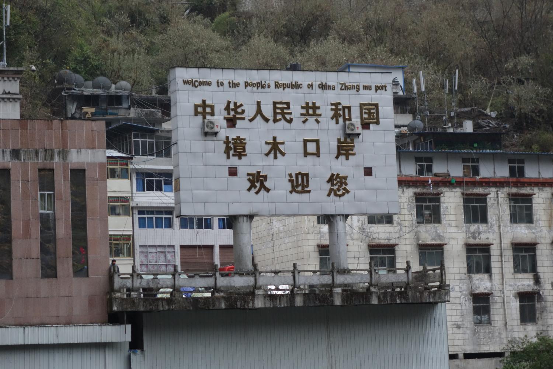 The weathered welcome sign on the Tibet-side of the Zhangmu-Kodari border