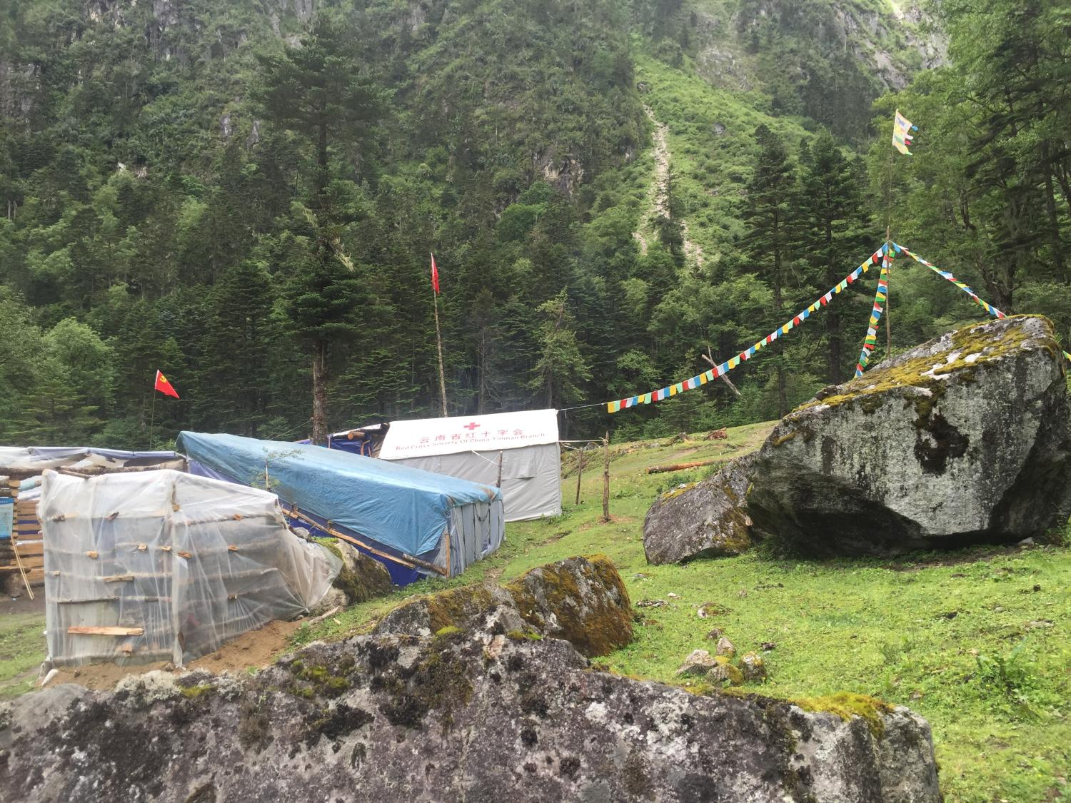 A rest stop along the way, including a rudimentary medicine dispensary (given out by a Tibetan from a local village with no medical training) in a Chinese Red Cross tent of unknown origin.