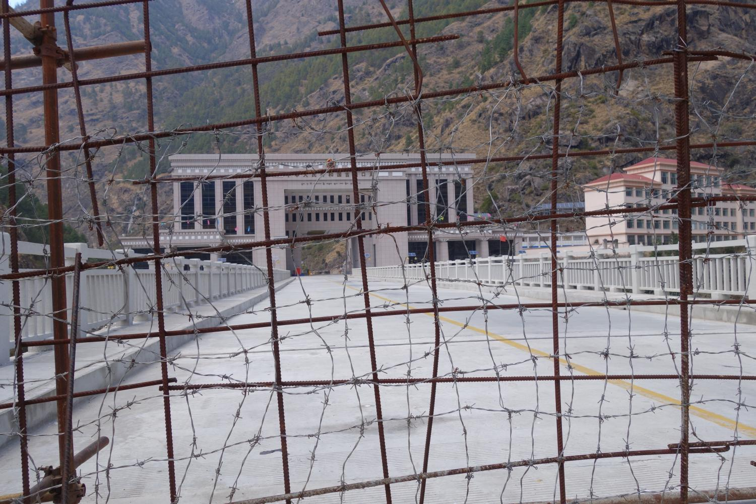 The rebar and barbed wire fence is opened numerous times per day for Nepali traders and Chinese laborers to shop at import-export markets on the Kyirong-side of the border