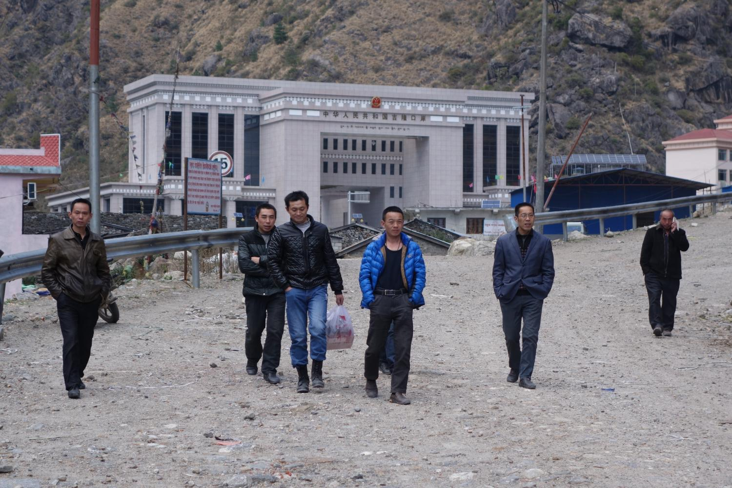Chinese laborers from the Rasuwaghadi hydropower station return to Nepal from the Kyirong market