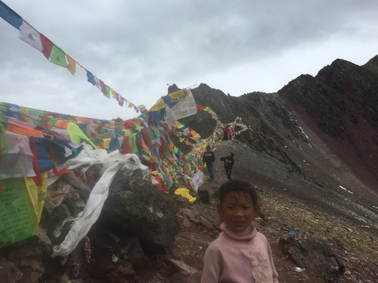 A young girl and two boys from Derong at the top of Shola.