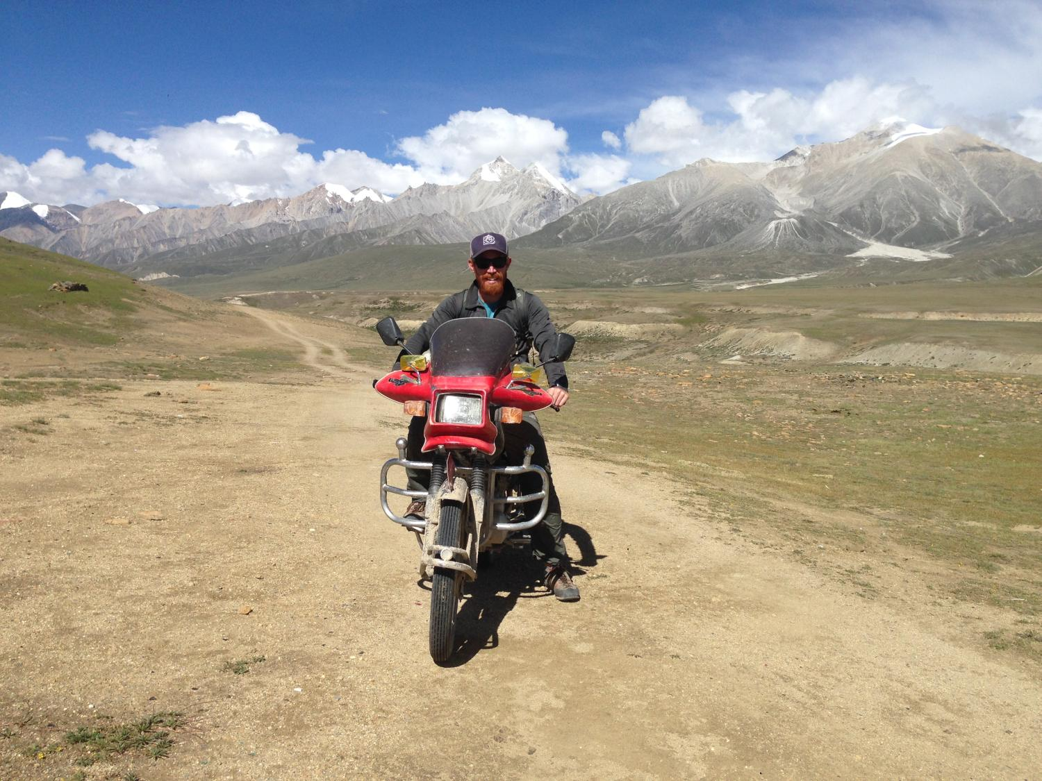 I used motorcycles to reach all three Nepal-China border posts. Here I'm sitting on my friend's Chinese motorcycle atop the Kora-la