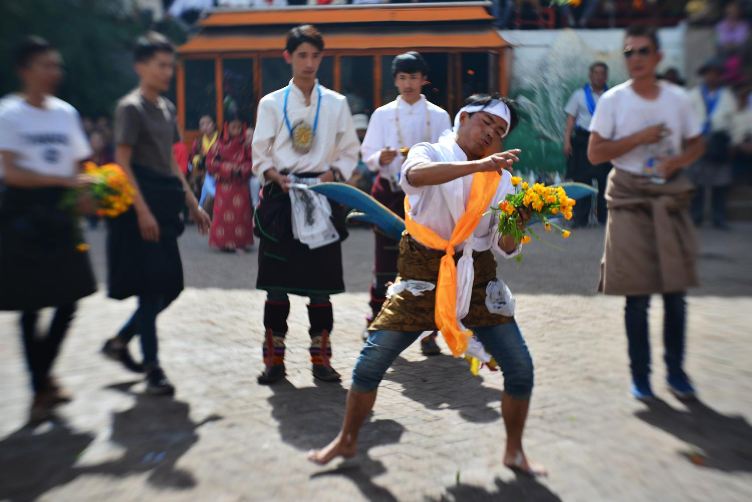 The  Anye Makhon (A mye dmag dpon ཨ་མྱེ་དམག་དཔོན) dance returned to Sadjye in 2017 after a decade plus absence due to the passing of the former dancer. It includes sword play and the kinetic tossing of burning paper, grain, and alcohol.