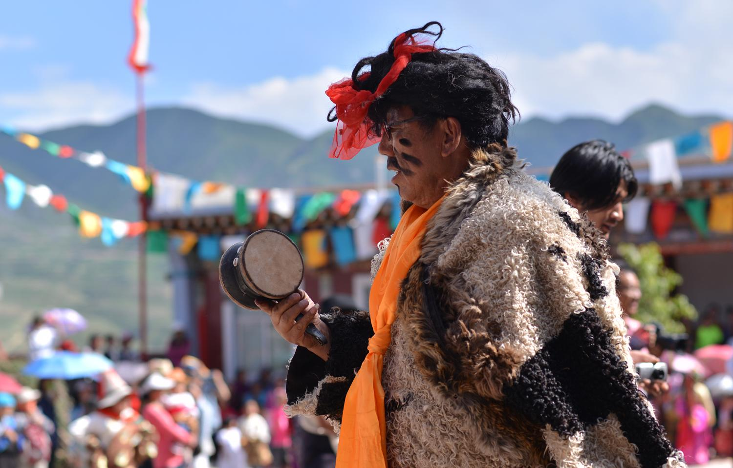 In the comedy portion of the festival, men dress up as women and animals and tell humorous stories. These stories are relevant to current community happenings and have a normative moral dimension.