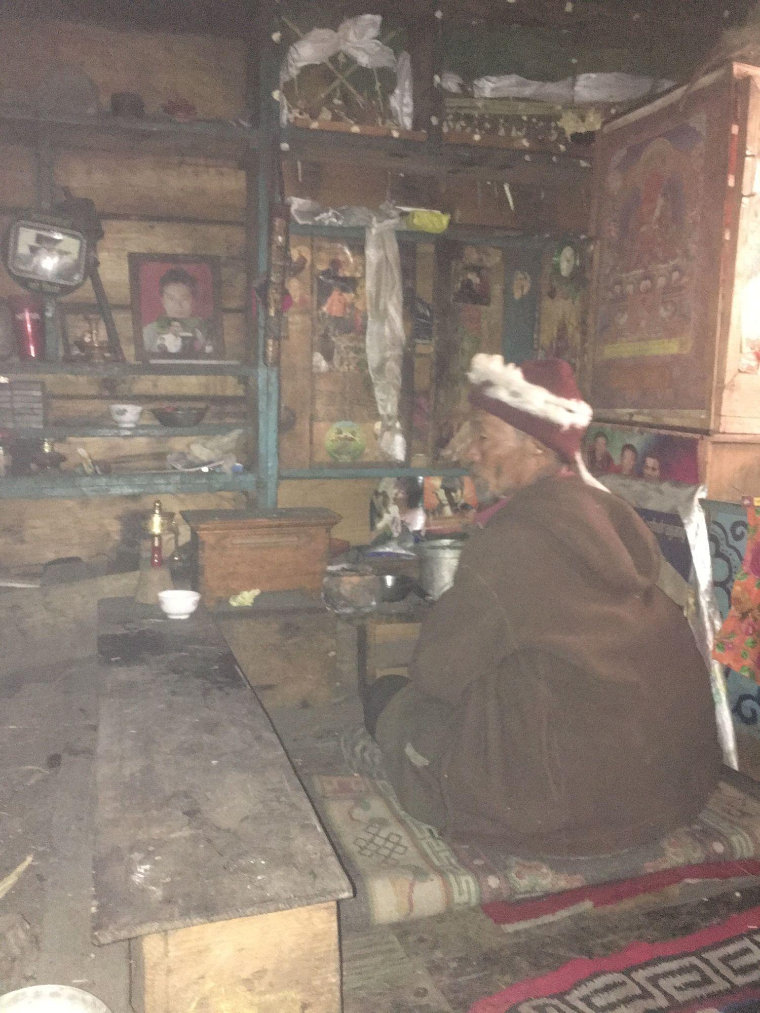 Lama Kunsang Nangsel performs a lhasol (house blessing), Tsak village.