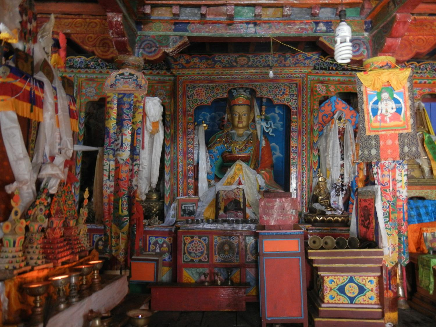 he interior of the Sama gompa. Note the image of Thangthong Gyalpo, the traditional founder of lhamo or Tibetan opera, in the upper right