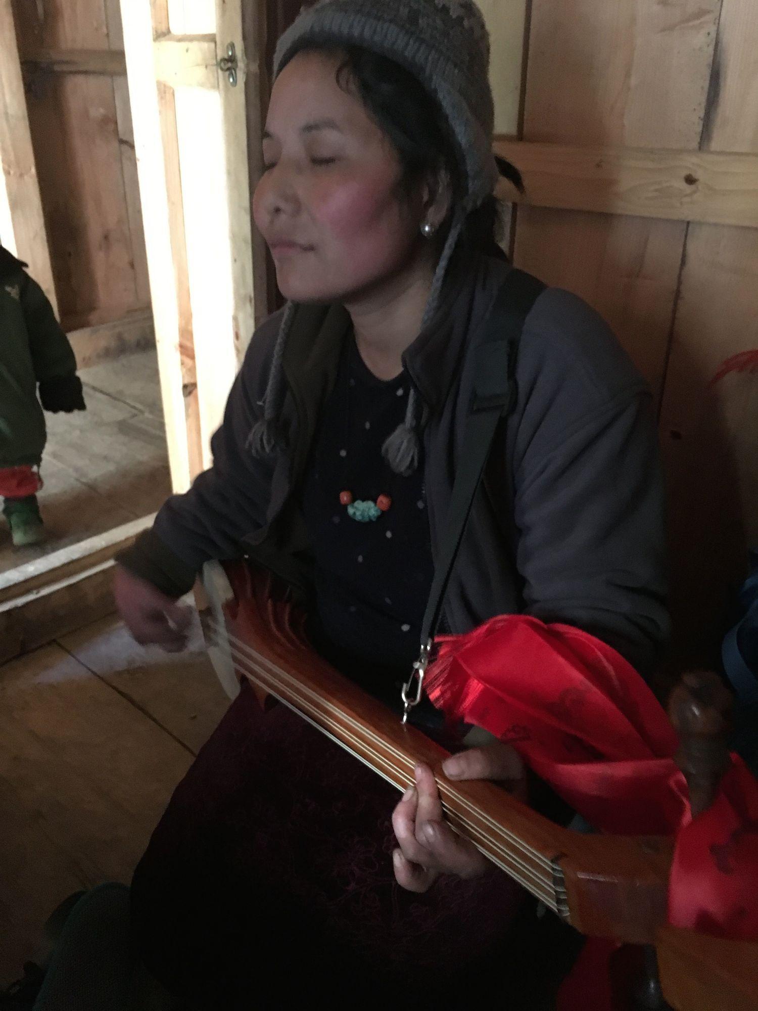 Dawa Lhamo plays the dranyen (Tibetan lute), Sho village.