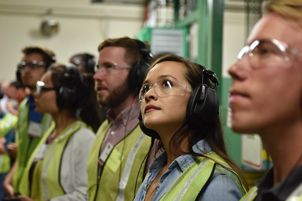 A CU Boulder student tours the high-speed beverage can manufacturing facilities in Golden during Ball Cooperation Career Day, 2018.
