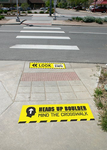 Heads Up Boulder crosswalk safety campaign signs