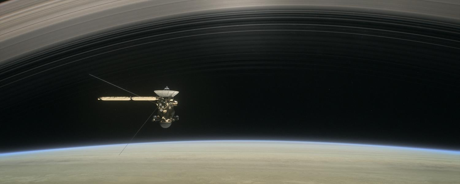 "Artist's rendering of Cassini flying below Saturn's rings during its ""grand finale."""