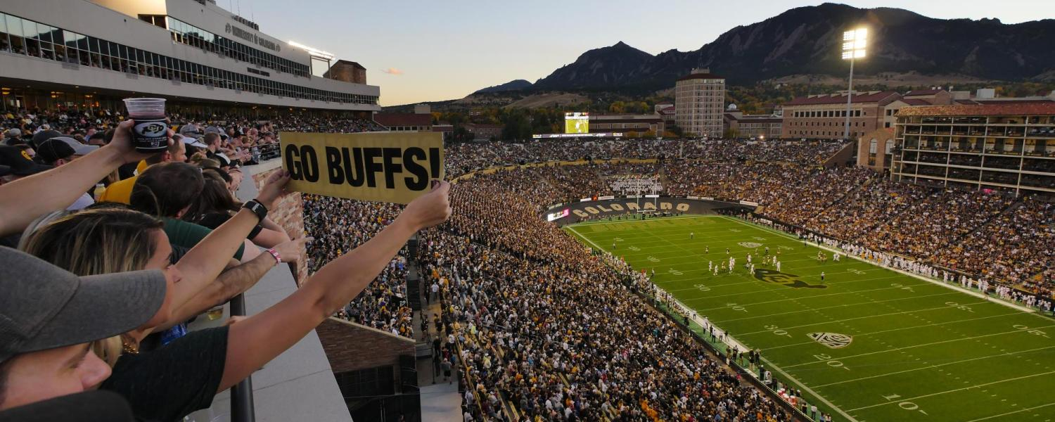 Folsom Field is packed with fans as the sun sets behind the Flatirons.