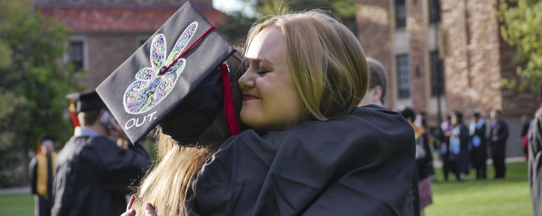 Two graduating Buffs share a hug