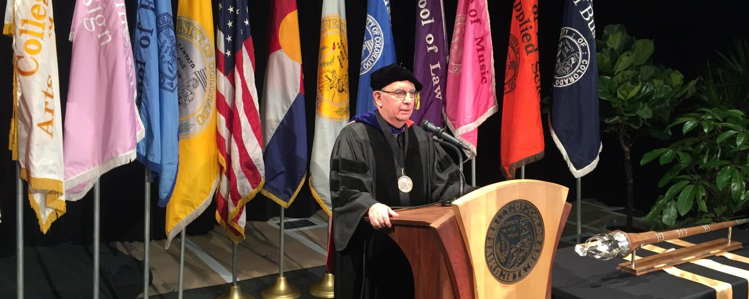 Chancellor Philip DiStefano delivers his commence remarks in front of a podium