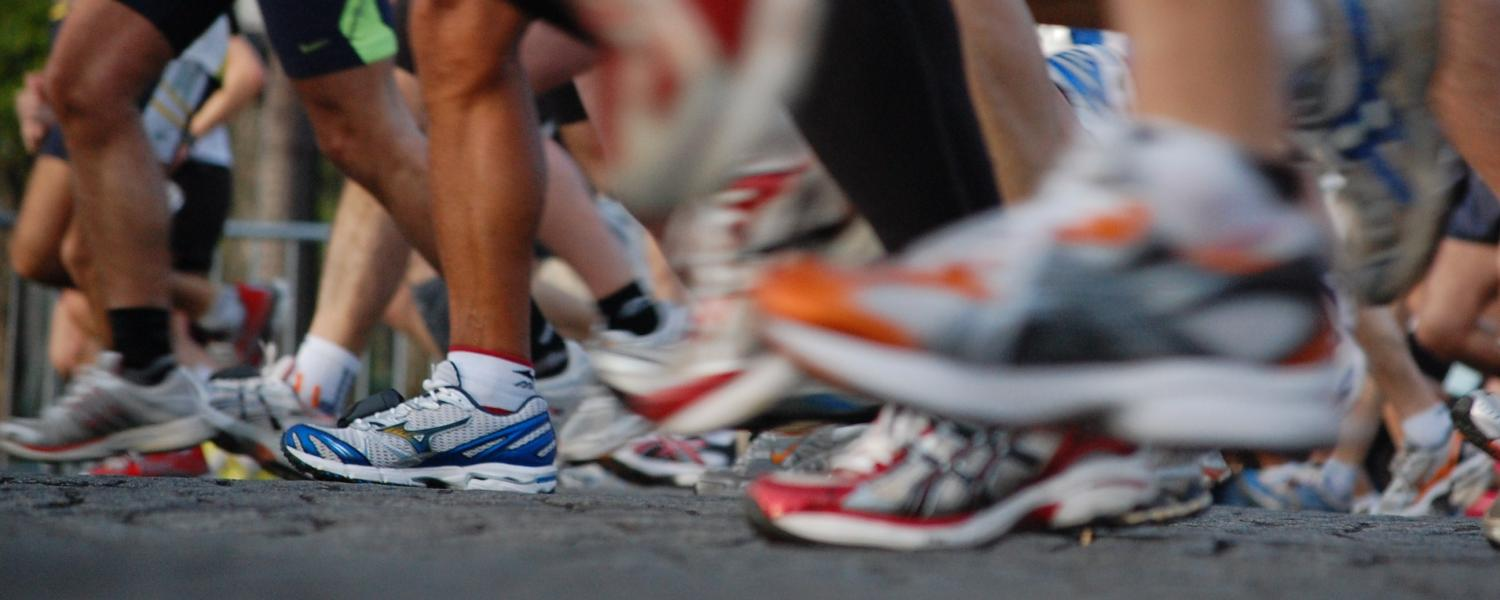 Photo of group of people running