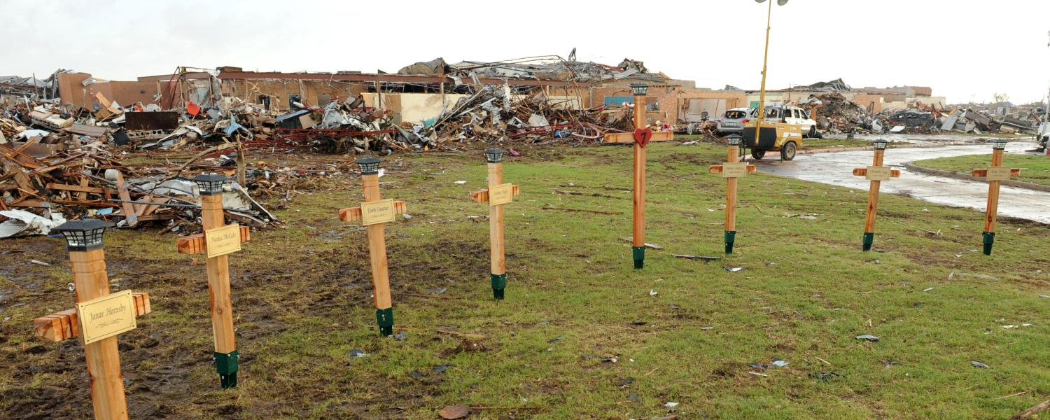 Crosses on the lawn in front of Plaza Towers Elementary School