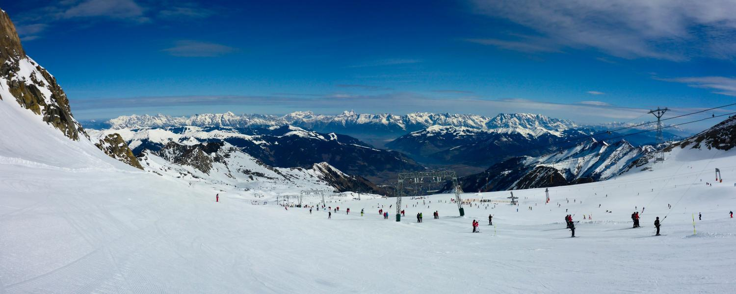 Skiers and mountain views