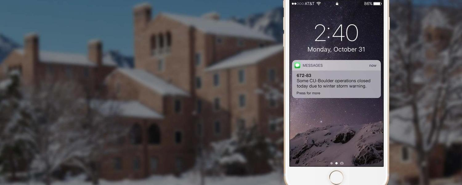 Image of phone showing an alert, over a snowy background