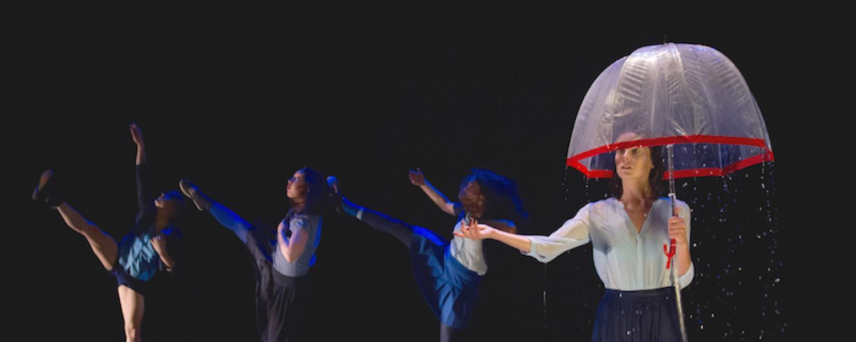 Dance performance, woman under umbrella