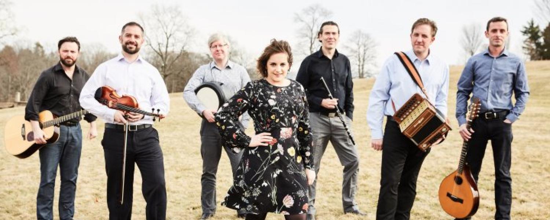 Irish folk ensemble Danu in an open field