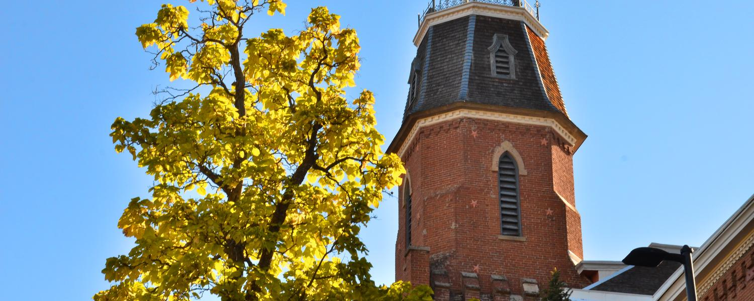 Old Main with fall leaves