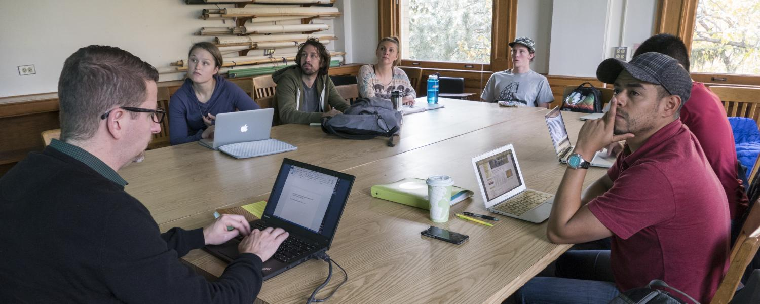 Faculty member teaches First-Year Seminar with students at same table