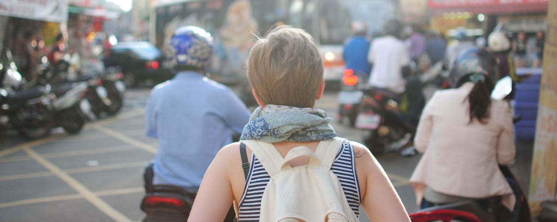 Woman wanders through busy street