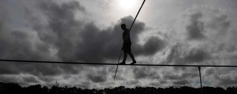 Man walks on high wire