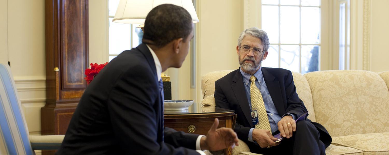 John Holdren speaks with President Obama in the White House