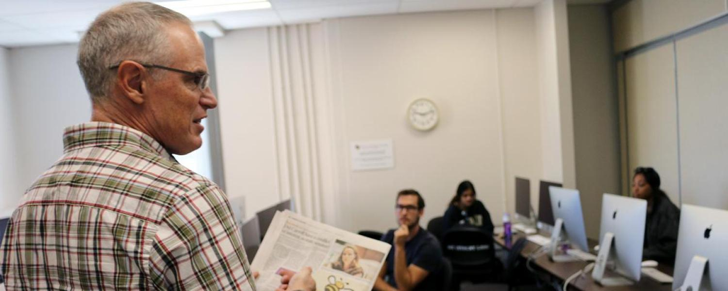News Corp instructor Jeff Browne discusses with the class the latest fact check piece published in The Denver Post