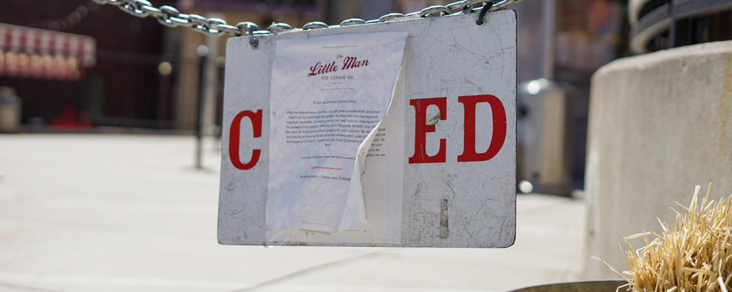 A closed sign in front of Little Man Ice Cream in Denver during the COVID-19 pandemic.