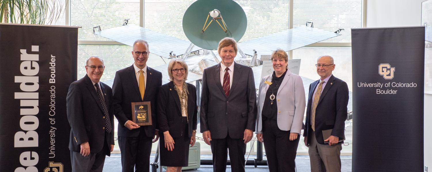CU President Mark Kennedy, second from left, poses with CU and LASP leadership during a tour of CU Boulder's Laboratory for Atmospheric and Space Physics (LASP) on July 1, 2019, Kennedy's first official day on the job. From left, Chancellor Phil DiStefano; Kennedy, Debbie Kennedy, Mark's wife; LASP director Dan Baker, Vice Chancellor for Research & Innovation Terri Fiez and Provost Russell Moore. (Photo by Glenn Asakawa/University of Colorado)