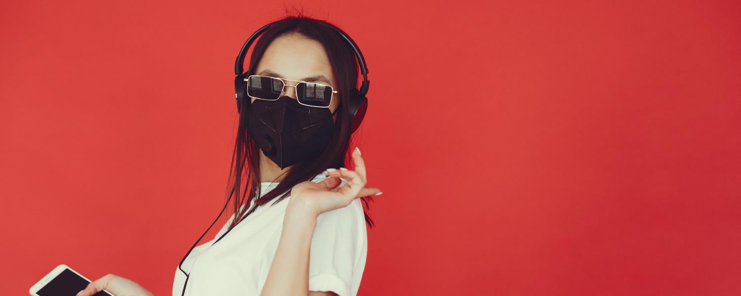 Girl listening to music with mask on