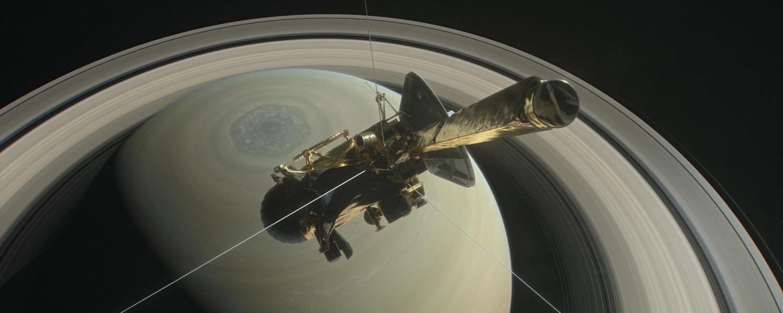 The Cassini spacecraft flies over Saturn