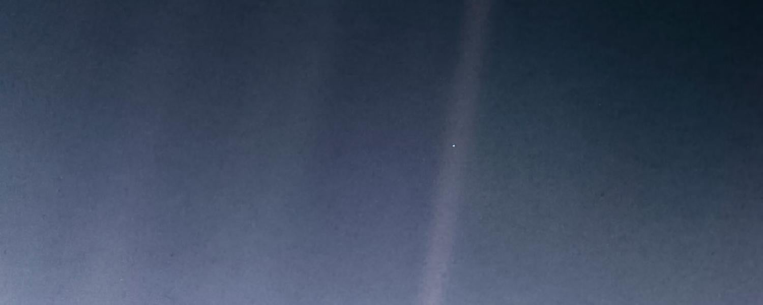 """NASA's famous """"pale blue dot"""" photo shows Earth as just a tiny pinprick of light in space."""
